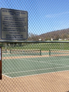 The community park courts, marked as property of the school district. (Photo: Ariane Cain)