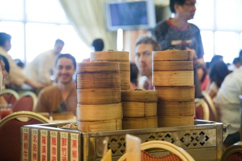 Check out the guy behind the cart eyeing the dim sum! :)