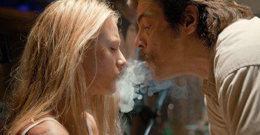 Lado (Del Toro) torments Ophelia (Lively) with marijuana