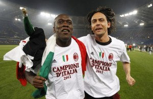 AC Milan's Seedorf and Inzaghi celebrate after winning the Serie A title in Rome