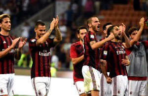 MILAN, ITALY - AUGUST 27: Players of AC Milan celebrate after winning the Serie A soccer match against Cagliari Calcio at San Siro Stadium in Milan, Italy on August 27, 2017. Pier Marco Tacca / Anadolu Agency