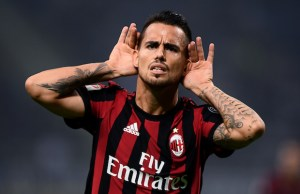 AC Milan's midfielder Suso from Spain celebrates after scoring during the Italian Serie A football match Inter Milan Vs AC Milan on October 15, 2017 at the 'San Siro Stadium' in Milan.  / AFP PHOTO / MARCO BERTORELLO