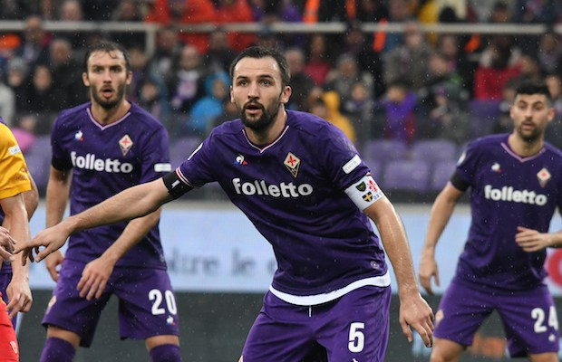 Fiorentina's midfielder and new captain Milan Badelj looks on during the Italian Serie A football match Fiorentina vs Benevento on March 11, 2018 at the Artemio Franchi stadium in Florence.  Fiorentina's captain Davide Astori likely died on March 4, 2018 in his hotel room from a cardiac arrest linked to the slowing of his heart rate following the initial results of his autopsy.  / AFP PHOTO / Claudio Giovannini