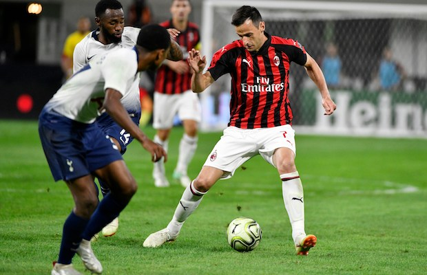 MINNEAPOLIS, MN - JULY 31: Nikola Kalinic #7 of AC Milan advances the ball past Georges-KÈvin N'Koudou #14 of the Tottenham Hotspur during the second half of the International Champions Cup 2018 match at U.S. Bank Stadium on July 31, 2018 in Minneapolis, Minnesota.   Jules Ameel/Getty Images/AFP