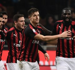 AC Milan's Polish forward Krzysztof Piatek (C) celebrates with teammates after scoring during the Italian Serie A football match AC Milan vs Cagliari on February 10, 2019 at the San Siro stadium in Milan. (Photo by Marco BERTORELLO / AFP)