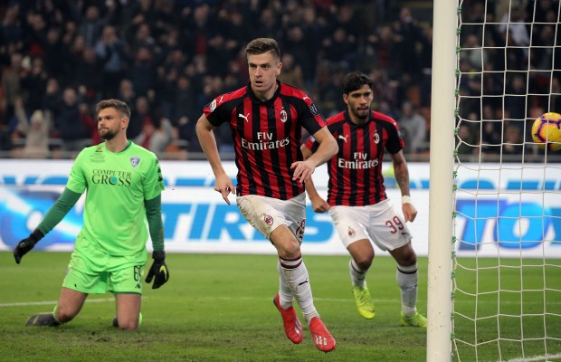 Krzysztof Piatek #19 of AC Milan scores his goal during the serie A match between AC Milan and Empoli FC at Stadio Giuseppe Meazza on February 22, 2019 in Milan, Italy. (Photo by Giuseppe Cottini/NurPhoto)