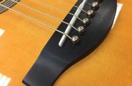 Yamaha LJ16BC Billy Corgan Signature Model Jumbo bridge with brass pins.