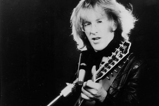 Paul Kantner of Jefferson Airplane and Starship with his Guild 12-string