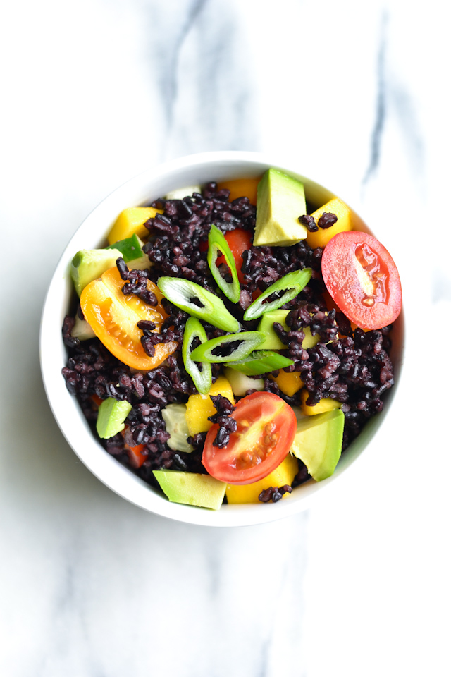 Colorful black rice salad with a tangy citrus dressing