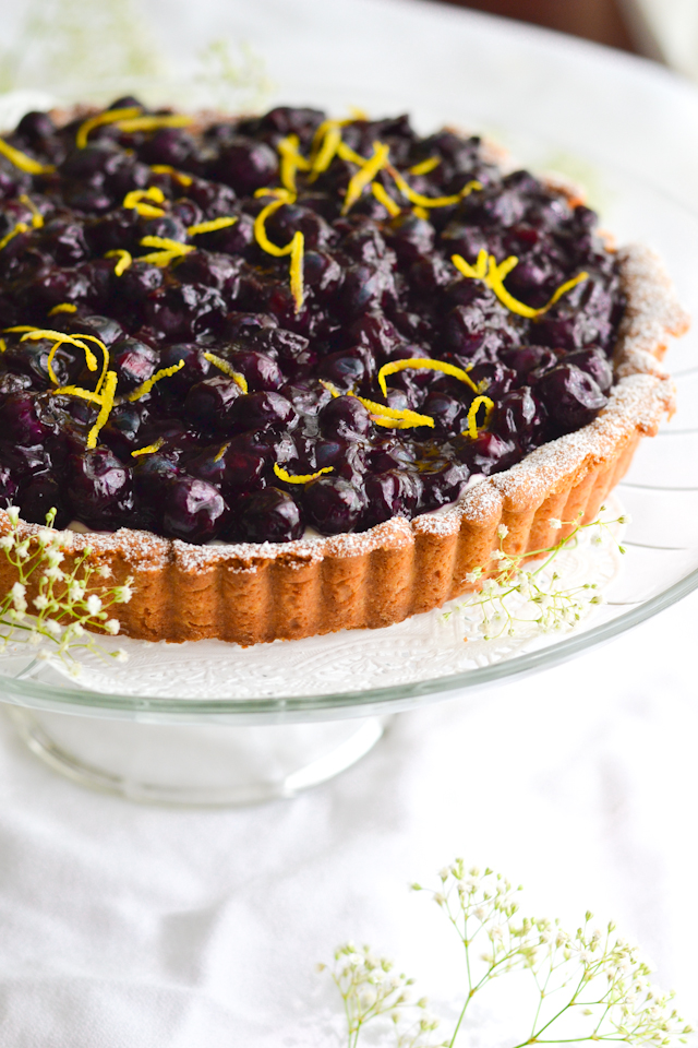 A delicious summer tart filled with sweet cream and topped with fresh glazed blueberries!