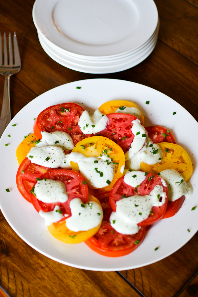 Fresh tomato salad with a tangy greek yogurt dressing!
