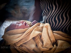 Newborn baby. Giving birth in the Bamu River region, Western Province, PNG.
