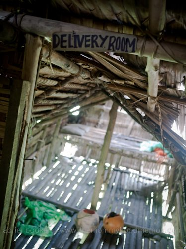 Delivery room. Giving birth in the Bamu River region, Western Province, PNG.