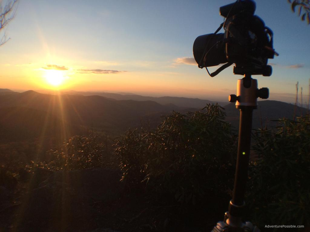 Photo of camera on tripod on backpacking adventure
