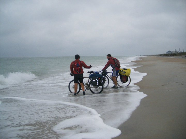 The author and friend dipping tires in Atlantic Ocean after cycling 4,500 miles across America.