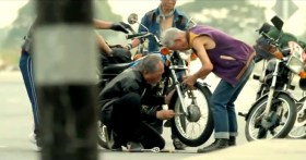 """Taiwan's TC Bank television commercial """"Dream Rangers"""": Old men fixing a motorcycle's front wheel."""