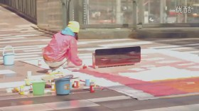 A Haier air conditioner in the middle of a 3D ground painting, supposedly to filter the odors released by the paints.