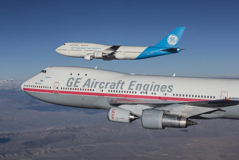 Nacelle chevrons distinguish the Leap-1B for Boeing's 737 MAX on the 747-100 flying testbed (foreground) compared with the larger Leap-1A for the A320neo on the 747-400 (background). Credit: CFM International #aerobdnews