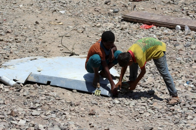 Boys check a part of a United Arab Emirates Mirage plane that crashed in Yemen's southern- #aerobdnews #thenewscompany