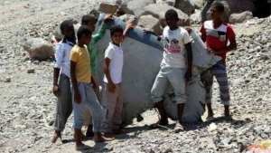 Boys check a part of a United Arab Emirates Mirage plane -thenewscompany