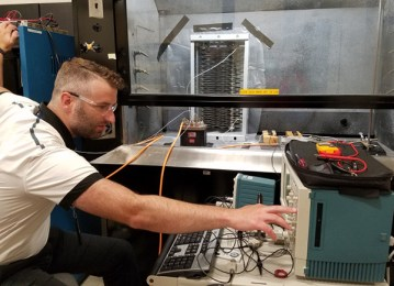 Corey Boltz, Air Force Research Laboratory electrical engineer, makes final adjustments before conducting a proof-of-concept arc test in preparation for follow-up testing to support a NASA research effort. (US Air Force photo by Holly Jordan)