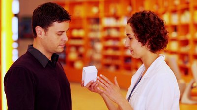 stock-footage-pharmacist-talking-to-customer-in-pharmacy-and-explaining-medicine