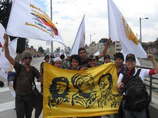 A contingent of Patriotic March High School students pose with AfGJ's and Pan Left's Raquel Mogollón. There banner has at its center Colombia's hero for peace and leading member of the Patriotic March, Piedad Córdoba, pictured here with Che Guevara and Simón Bolívar--an indication of the high esteem in which she is held. Photo by James Jordan.