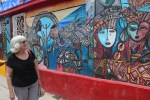 Delegate Pamela Brubaker looks at one of many murals to be found around Havana