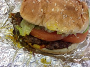A tasty burger from my all time favorite burger chain started locally in Virginia -- Five Guys! This burger is topped with mustard, ketchup, mayo, lettuce, tomato, and pickles!  (Photo Credit: Adroit Ideals)