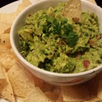 My favorite creamy Guacamole served with crispy Tortilla Chips (Photo Credit: Adroit Ideals)