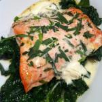 Baked Salmon with Creme Fraiche and Tarragon over a bed of sauteed Spinach  (Photo Credit: Adroit Ideals)