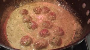 Add the turkey meatballs to the sauce, then add the basil pesto, and warm through.  (Photo Credit: Adroit Ideals)