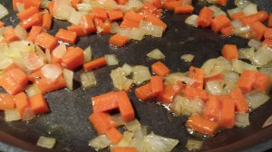 Saute the onions and carrots (Photo Credit: Adroit Ideals)