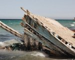 The remains of a refugee boat seen on the beach in Zuwara, Libya, Aug. 17, 2016. According to locals, the boat was washed ashore alongside many bodies of drowned refugees and migrants. Zuwara used to be the main departure point for refugees and migrants getting smuggled to Europe over the Mediterranean. The business was banned by the local council after several hundreds of bodies were washed ashore in 2015. The ban is enforced by a militia known as the Black Masks. Human smuggling moved to nearby Sabratah and Zuwara turned to oil and diesel smuggling.