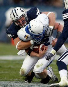 "Bringham Young defensive end Jan Jorgensen, pictured tackling Air Force quarterback Ben Cochran, said at a press conference before playing Air Force that the Falcons play ""legal, but dirty."" (AP photo)"
