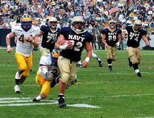 Former Navy fullback Kyle Eckel sprints to the end zone during a 2004 game against Delaware.
