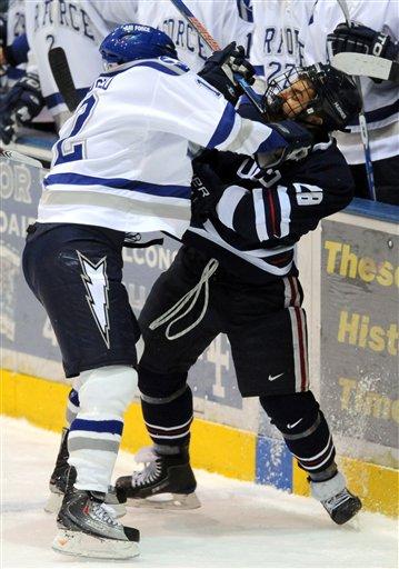 Air Force forward Matt Fairchild checks Connecticut defenseman Brad Cooper in the first period of an NCAA college hockey game Saturday at Cadet Ice Arena. (Kevin Kreck / The Gazette via AP)