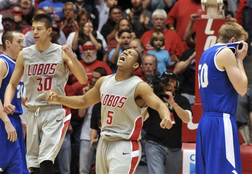 New Mexico's Dairese Gary screams as the buzzer goes off at the end of New Mexico a 59-56 victory over Air Force Feb. 20 in Albuquerque. Walking away at right is Air Force's Grant Parker. (AP Photo/Albuquerque Journal, Roberto E. Rosales)