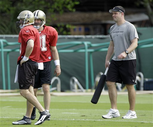 New Orleans Saints quarterbacks coach Joe Lombardi, right, works with quarterbacks Mark Brunell, center, and Drew Brees, left, during practice Feb. 4. Lombardi played football for the Air Force Academy in the 1990s. (AP Photo/Mark Humphrey)