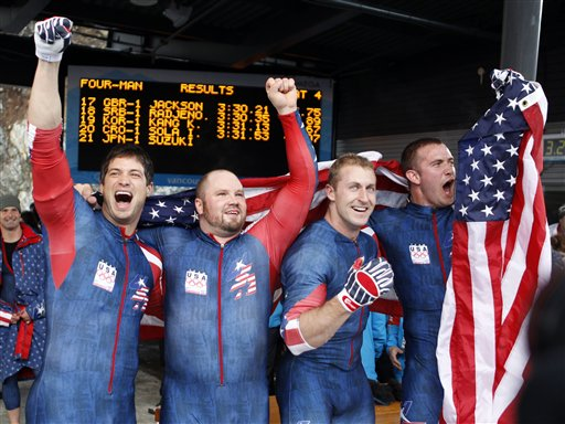 Members of USA-1, including pilot Steven Holcomb, second from left, celebrate their gold medal finish during the men's four-man bobsled final competition at the Vancouver Olympics in Whistler, British Columbia on Saturday. (AP Photo/Michael Sohn)