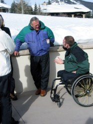 Former Staff Sgt. Heath Calhoun speaks with former SecDef Donald Rumsfeld during a 2006 encounter. Calhoun will carry the U.S. flag at the opening ceremonies for the Vancouver Paralympics, which will be held Friday.