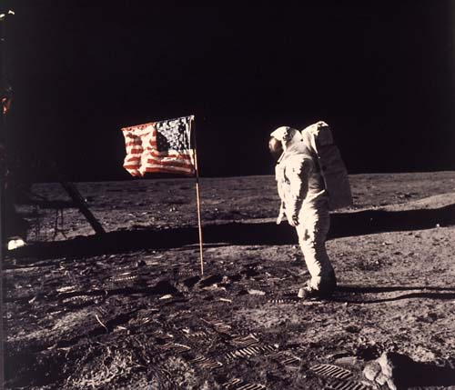 """Buzz"" Aldrin poses for a photograph with the U.S. flag during the moon landing on July 20, 1969. (AP Photo/Neil Armstrong, NASA, file)"