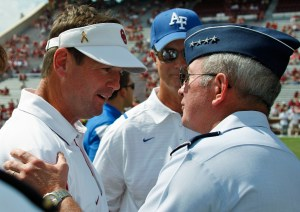 Oklahoma coach Bob Stoops greets Air Force Gen. Duncan McNabb, commander of U.S. Transportation Command, before the game. (Sug Ogricki / The Associated Press)