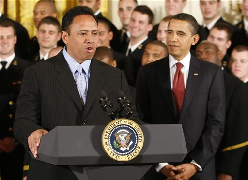 Navy head football coach Ken Niumatalolo speaks at the White House during the presentation of the Commander in Chief's Trophy to Navy in 2009. The coach's high-profile success has earned him a spot in the seven-member inaugural class of the Polynesian Football Hall of Fame.  (Associated Press photo by Gerald Herbert)