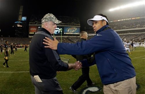 Navy coach Ken Niumatalolo, right, shakes hands with Army coach Rich Ellerson after Navy's 17-13 win over Army in December. (Associated Press photo by Matt Slocum)