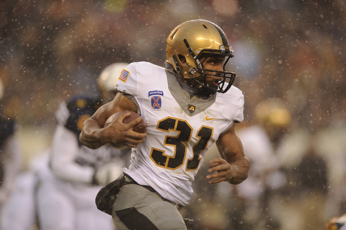 Army running back Terry Baggett carries the ball as snow falls on the 114th Army-Navy football game at Lincoln Financial Field in Philadelphia, Pa., on Saturday, December 14, 2013. (Mike Morones/Staff)