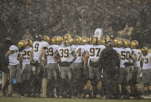 The Black Knights huddle under a heavy snow during the 114th Army-Navy football game at Lincoln Financial Field in Philadelphia, Pa., on Saturday, December 14, 2013. Navy won for the 12th straight year, 34-7. (Mike Morones/Staff)