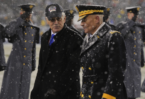 Secretary of Defense Chuck Hagel crosses the field with West Point superintendent Lt. Gen. Robert Caslen Jr at halftime of the 114th Army-Navy football game at Lincoln Financial Field in Philadelphia, Pa., on Saturday, December 14, 2013. (Mike Morones/Staff)