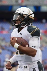 Navy quarterback Keenan Reynolds models the runner-up in this year's Helmet Madness contest, which the Navy Midshipmen wore in their 2014 season-opening loss to Ohio State in Baltimore (USA Today Sports photo by Tommy Gilligan)