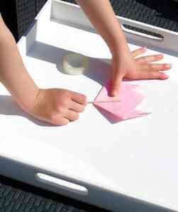 Photo instruction of Child Making Simple Origami Tulip